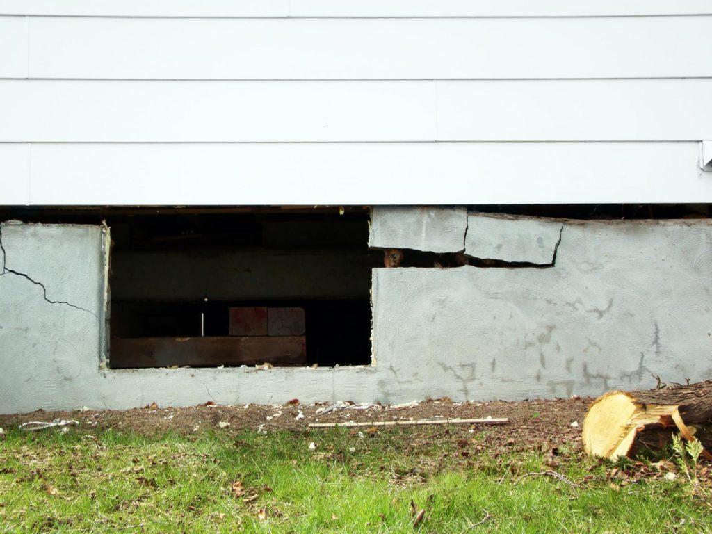 damaged concrete foundation of a house