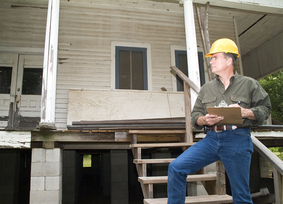 man inspecting the old house